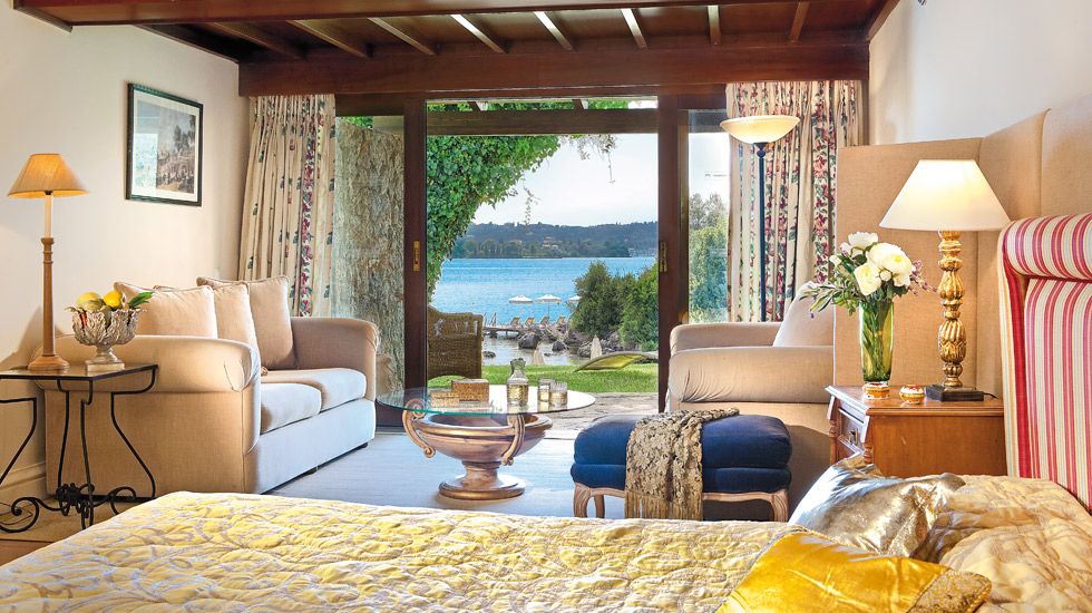 Junior Bungalow Suite |Bedroom doubles as a sitting room offers views over palm fringed gardens running down to the sea